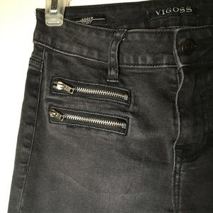 Faded black skinny jeans with zippers